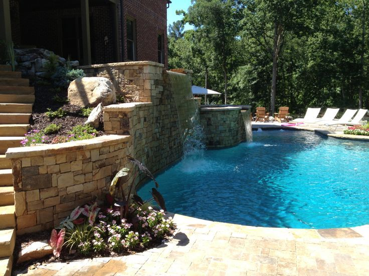Stack stone pool walls, built in flower beds