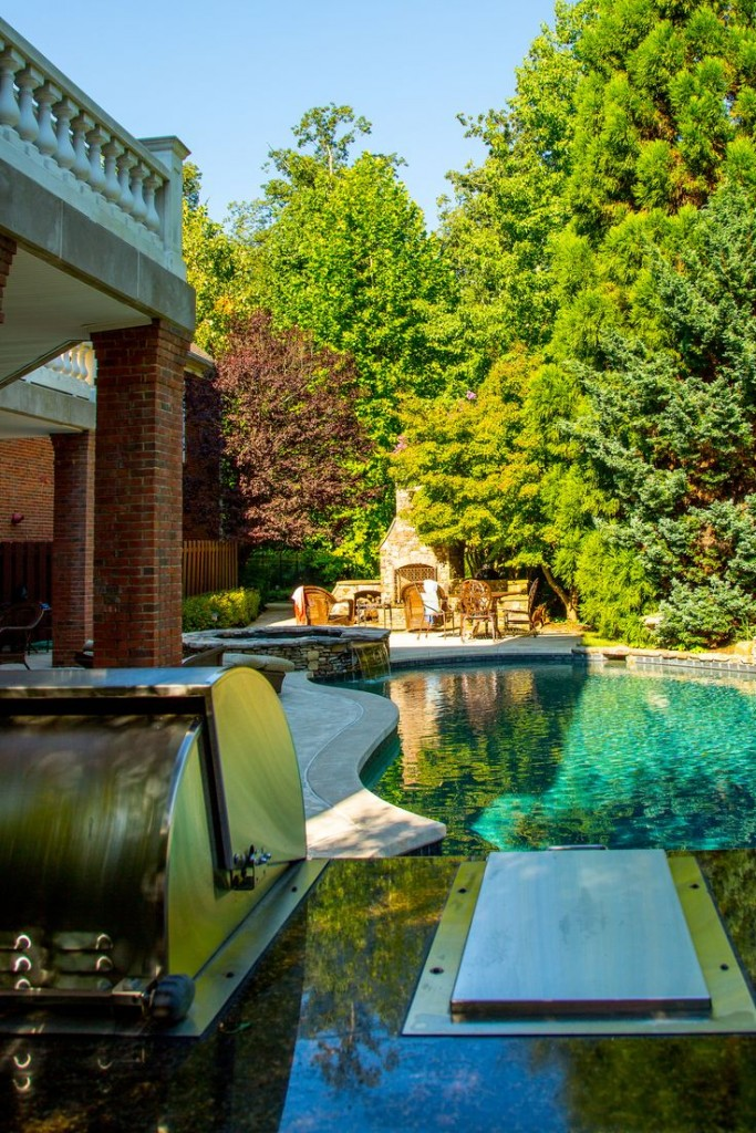 Beautiful free form pool with stack stone spa