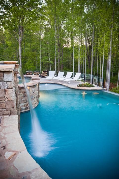 Hot tub with overflow into pool