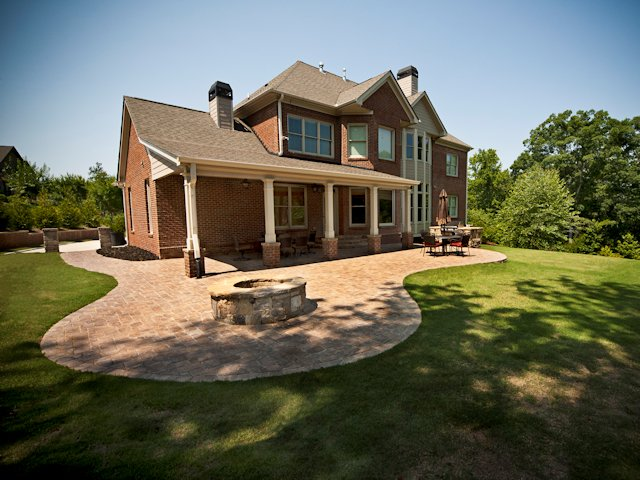 covered_porch_with_outdoor_patio_and_firepit