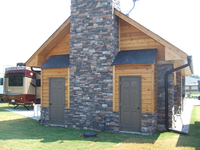dawg_house_pavillion__outside_fireplace_with_storage_closets_2